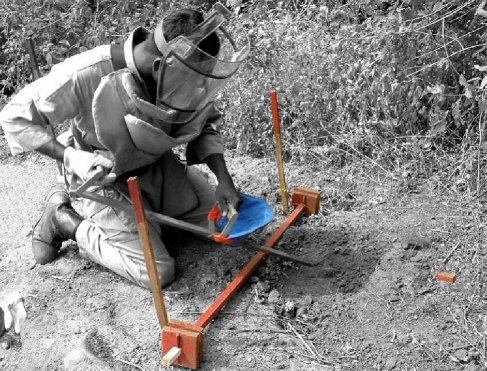 a deminer using the tool